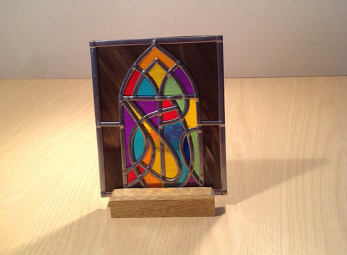 Arched window stained glass tea-light on oak plinth