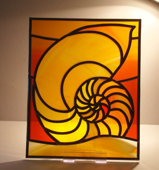 Shell design stained glass panel