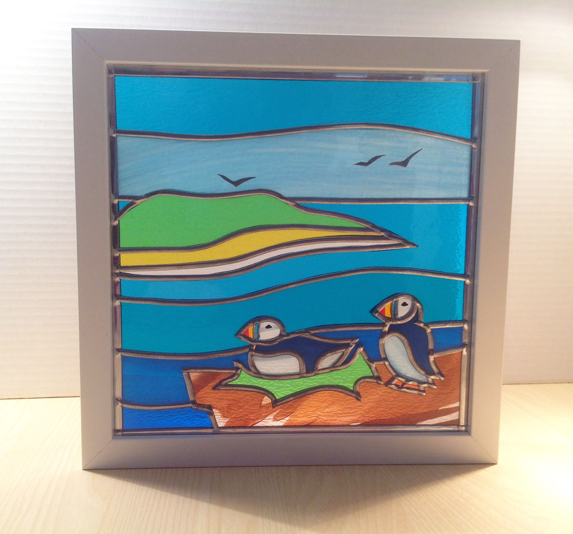 Stained glass puffins