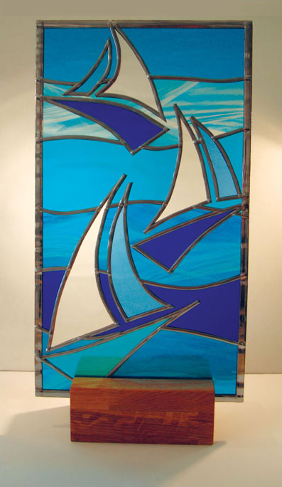 Stained glass yachts on oak plinth