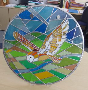 Stained_glass_circular_Flying_Barn_Owl